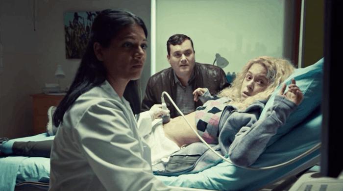 Kristian Bruun and Tatiana Maslany as Helena watch an ultrasound in Orphan Black
