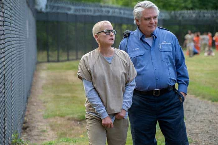 Lori Petty and Michael Harney in Orange is the New Black