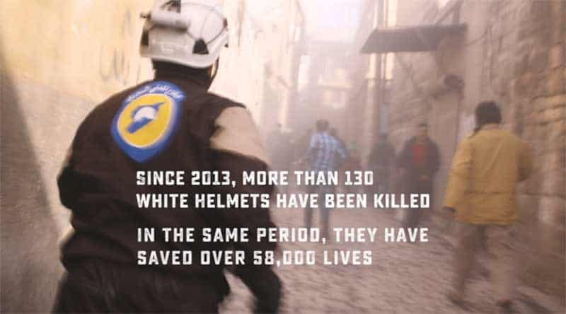 man in The White Helmets runs to a bombing site