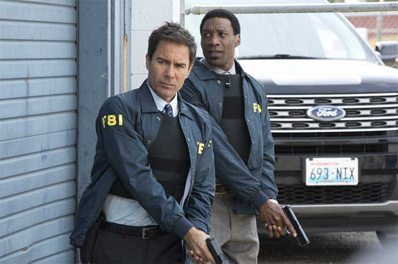 Eric McCormack and Arnold Pinnock in Travelers