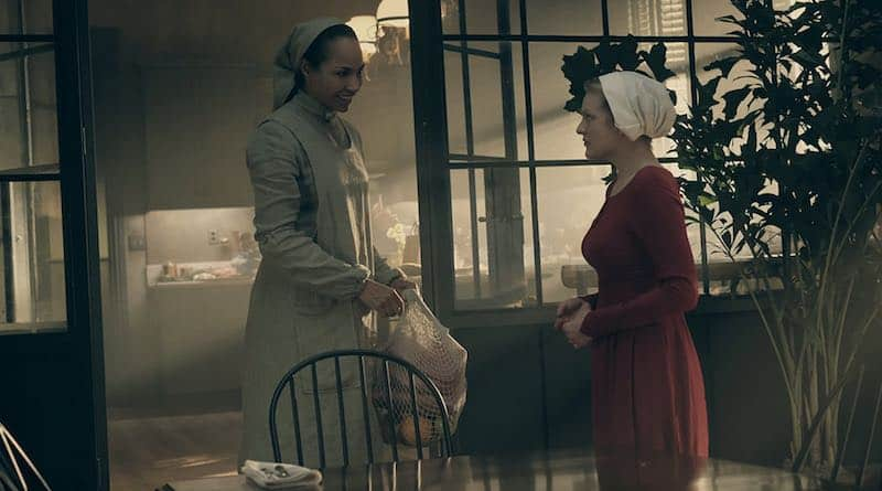 Amanda Brugel and Elisabeth Moss in The Handmaid's Tale