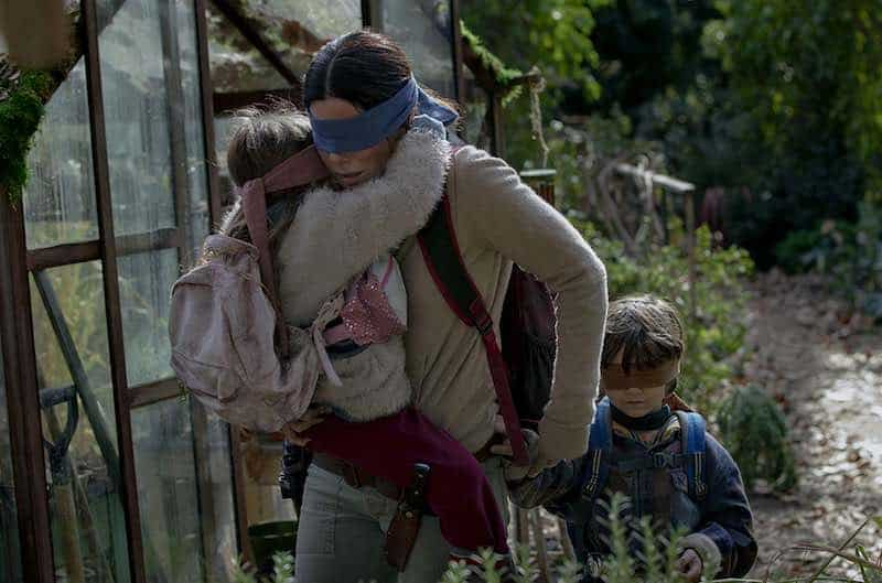 Vivien Lyra Blair, Julian Edwards and Sandra Bullock in Bird Box.