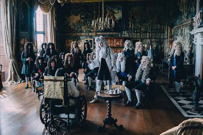 Nicholas Hoult in the center of the frame as Harley in The Favourite