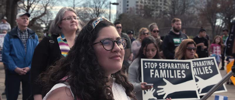 An activist at a protest against ICE in Immigration Nation