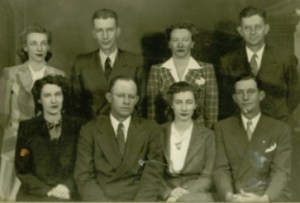 My grandfather, Cecil Lee Robison, and his 7 siblings. Cecil Lee is in the upper right  hand corner.
