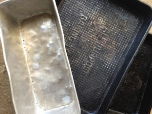 two old cooking trays