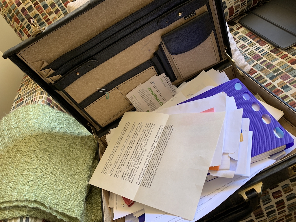 An open briefcase filled with papers.