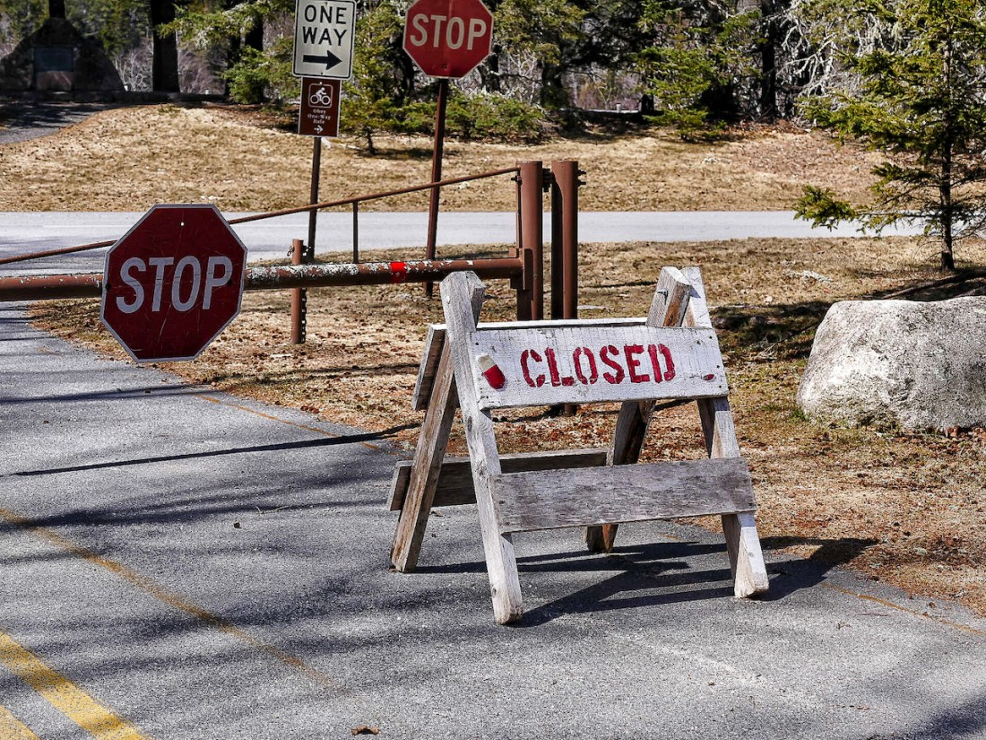 a closed sign on a road