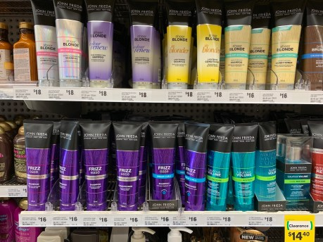 Tubes of hair products on supermaket shelf