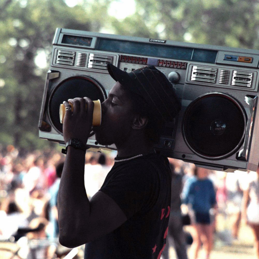 80's nostalgia: Picture of 80s man with a boom box on shoulder