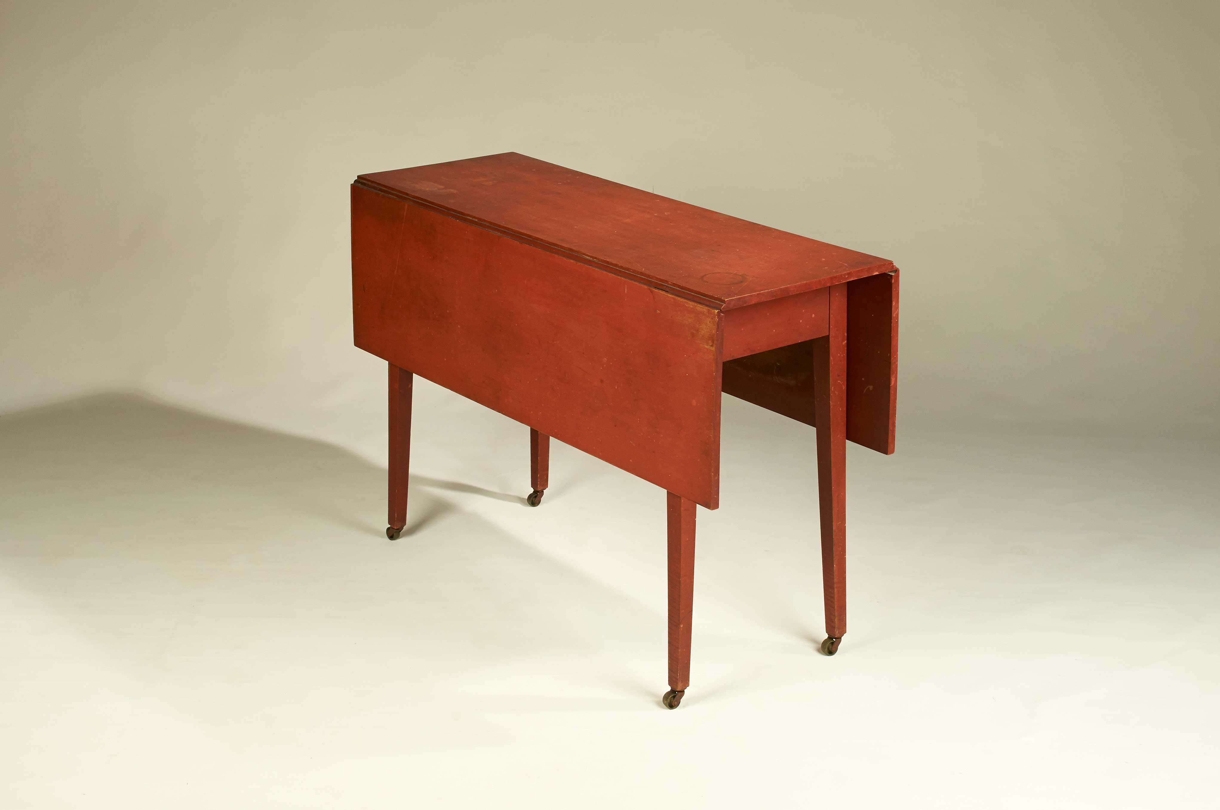 red-painted drop-leaf table rel=