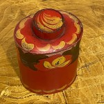 red toleware tea canister