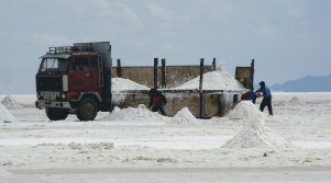 Workers load salt into trucks