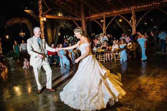 father-daugher-dance-on-stone-patio-wimberley-wedding-venue