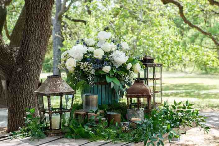 roses-lanterns-outdoor-decor-old-glory-ranch-wedding-venue-near austin