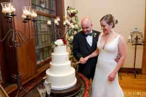 live-stream-cake-cutting-indoor-reception-ranch-wedding-sun-gold-photography
