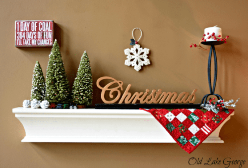 A decorated shelf above the loveseat