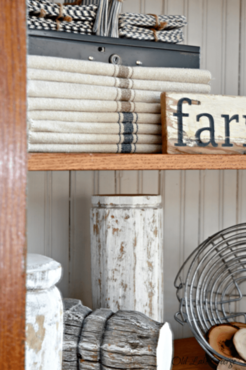 barn red cabinet with farmhouse items