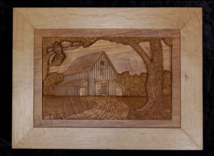 pictorial relief scene of a barn