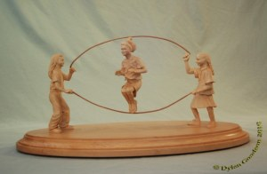Girls at play Girls jumping rope carved by dylan goodson