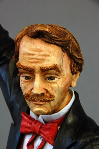 A close up of the face of Dylan Goodson's Magician woodcarving