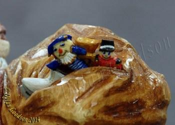 Santa Claus woodcarving Dylan Goodson close up of bag