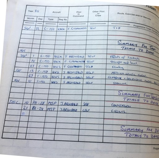 Flight Log Book of former student - John Archibald and Frank Giovannetti listed as pilots in command
