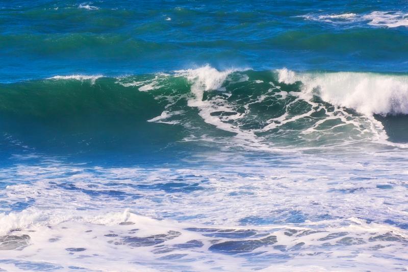 waves splashing beach