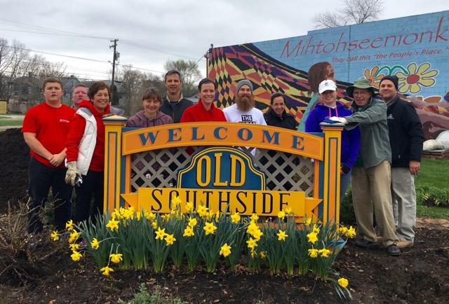Neighborhood volunteers gathered around Old Southside welcome sign.