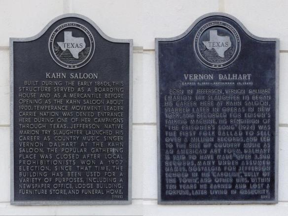 Two Texas Historical Markers in Jefferson, Texas commemorating the Kahn Saloon and Vernon Dalhart.