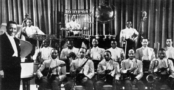 Duke Ellington with his orchestra at the Cotton Club sometime in the 1930s. From Jazzmen, 1938.