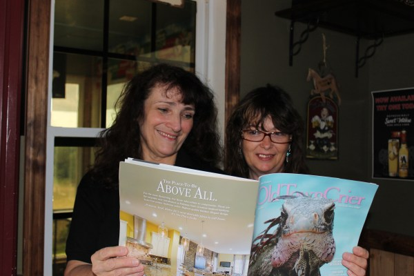 Tina Mayes, co-owner of Mick and Tina's Country Tavern in Augusta, WV and Nancy Clutter take a peek at the Old Town Crier to see what's happening in the big city. Mick & Tina's is a must stop kind of place while on a road trip to Cumberland Gap in northern Maryland.