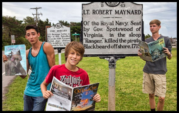 Marco Toro, Emerson Minor and Quinn Minor from Morgantown, WV enjoying the Old Town Crier on Ocracoke Island photo by Chester Simpson.