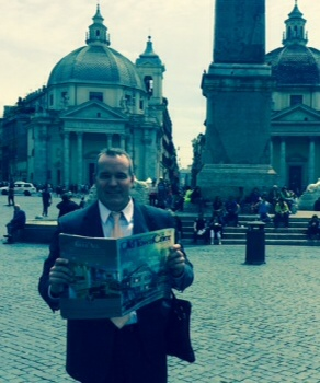 Harold Stafford enjoying the Old Town Crier during his latest business trip to Rome, Italy.  The photo was taken at the Piazza Del Popolo!
