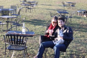 A couple with their dog enjoying the outdoors at three Fox Winery.