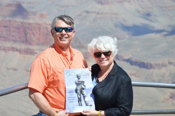 """Lee Anne Fuller and her husband Frank took the Old Town Crier """"On the Road"""" to the Grand Canyon. While Frank has owned a place in Alexandria for over 4 years, he and Lee Anne just became permanent residents of Old Town this spring. """"We love your magazine,"""" states Frank. We love it that you love our magazine as well!"""