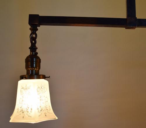 Craftsman chandelier 42 inch lit close up view