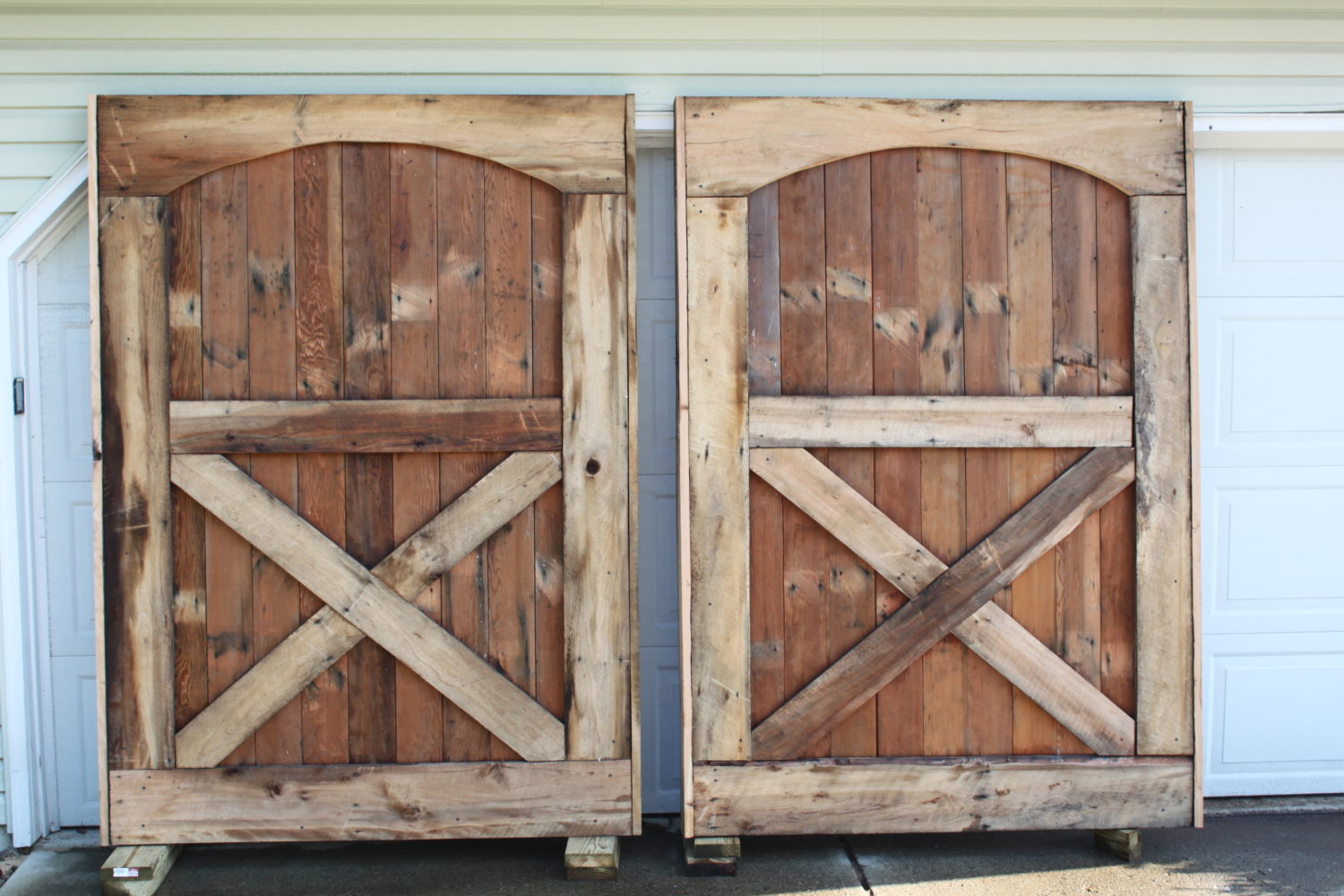 the barn doors we built from old flooring for our barn a few years back