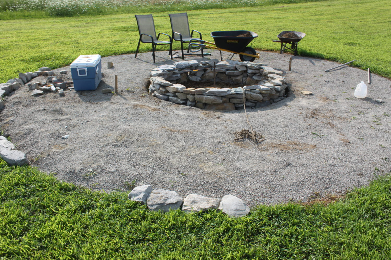The completed stone fire pit project how we built it for for What rocks to use for fire pit