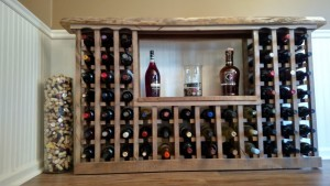 Our wine rack created for free from old barn and pallet wood.