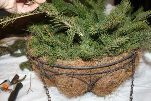 Place branches inside the basket - mounding them up in the center.