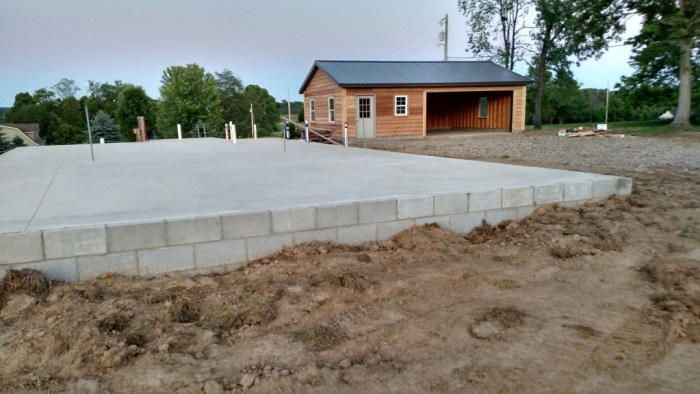 With the garage complete in the background., the foundation for the house sits ready for the builders this week!