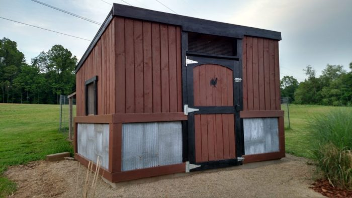 The Chicken Coop with a fresh coat of paint. We built the majority of the coop with reclaimed metal roofing and barn wood.