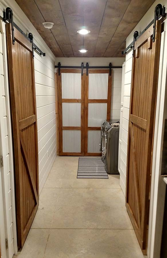 Our Barn Doors In The Main Hallway Allow For Maximum Space. The Back Doors  We Built With Corrugated Metal To Add A Unique Look.