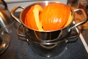 Pumpkin quarters in the double boiler steamer ready to be cooked down