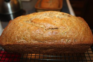 Zucchini bread cooling after being removed from the oven.