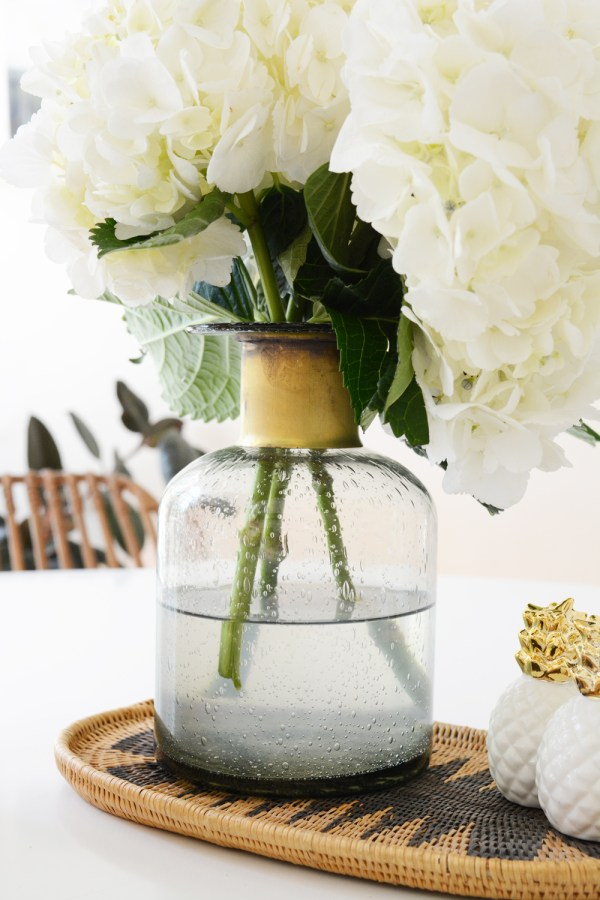 Sunroom Makeover. White hydrangea in grey and brass vase.