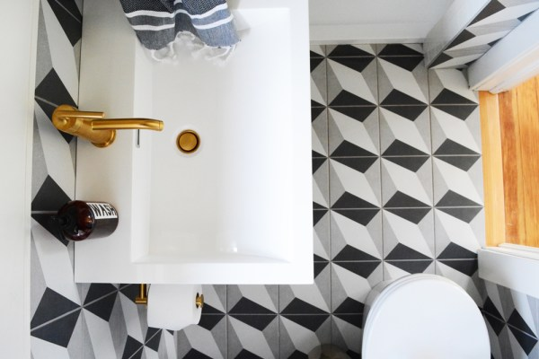 Guesthouse Bathroom Reveal - Bold patterns, crisp clean white tile, and brass fixtures.