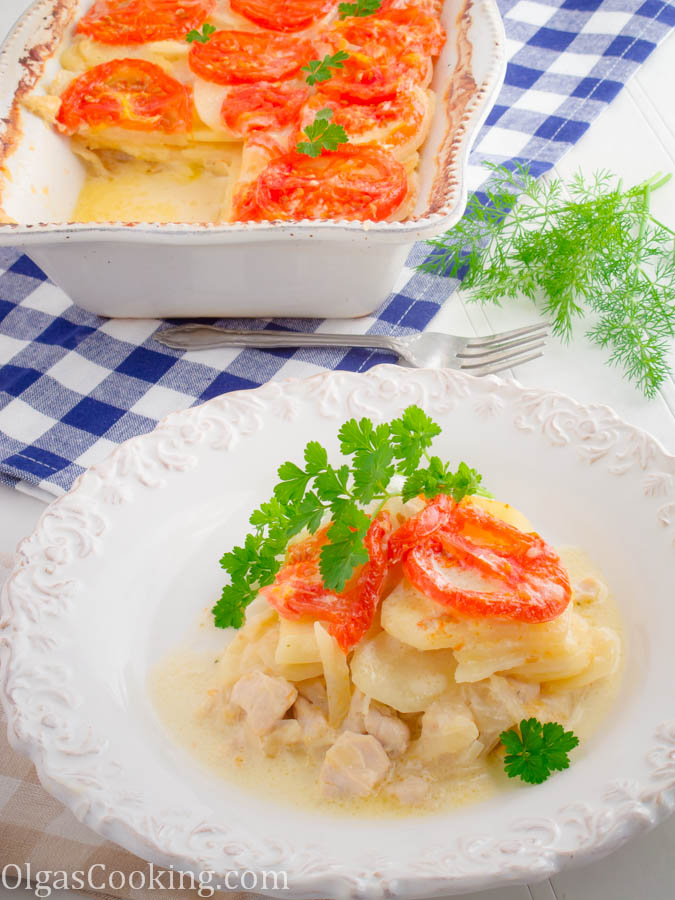 one dish wonder casserole with soft chicken, potatoes and creamy Alfredo sauce, topped with sliced tomatoes