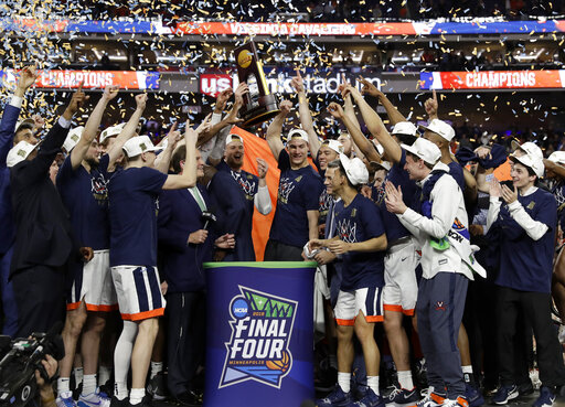 Virginia players celebrate with the championship trophy after defeating Texas Tech 85-77 in the overtime in the championship of the Final Four NCAA college basketball tournament, Monday, April 8, 2019, in Minneapolis. (AP Photo/David J. Phillip)